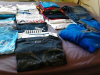 Mens' clothing bundle includes 19 T-shirts, 1 pr jeans, 1 hoodie
