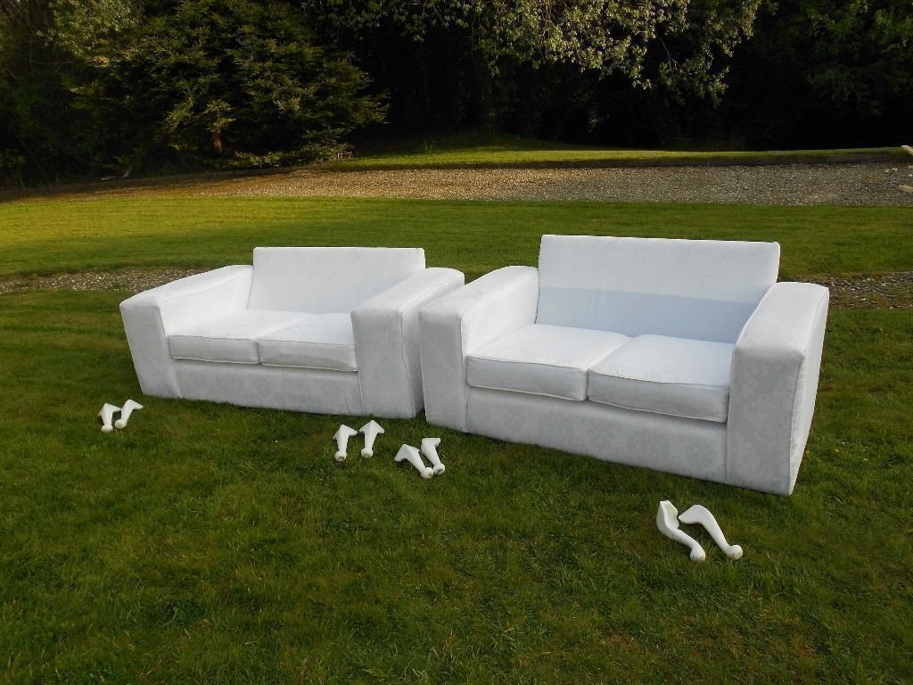 2 Gleaming White Sofas (Weddingin Londonderry, County LondonderryGumtree - 2 gleaming snow white sofas,ideal for house,hotel weddings, beauty,hairdressers etc.You wont find any like these around.Immaculate as new condition.With curvy white legs(taken off for transport).Just look at the pattern of the material,real...