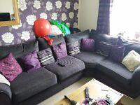 Large purple/black corner sofa
