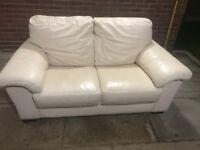Cream leather two seater sofa ..