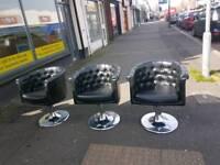 Black leather button back salon chairs