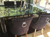 Glass dining table and 4 ring back chairs.