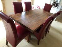 Wood dining table and 6 red leather chairs