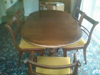 Mahogany Dining Room Table with extension leaf and 8 chairs good condition.