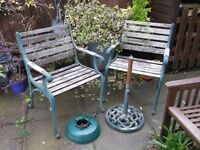 2 CAST IRON GARDEN CHAIRS 2 PARASOL BASES