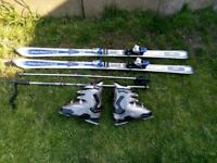 Rossignol 174cm skies and size 10 boots with poles