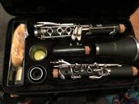 Windsor clarinet, case, cleaning cloths and two reeds