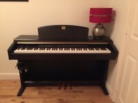 Yamaha Clavinova CLP 130 in Rosewood finish. Complete with Yamaha stool and full owners manual