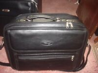 Hand and shoulder carrying overnight or day case: leather: zippered
