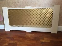 Brass grille 55cm x 127cm used as radiator cover