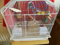 Bird cage with toys and bird bath food and sheets