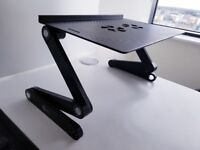 Adjustable laptop stand with accessories