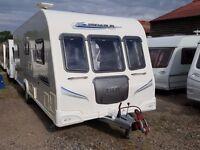 Bailey Pegasus 534 4 Berth Fixed Bed End Washroom Caravan with Motor Mover
