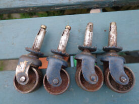 A set of 4 vintage steel furniture castors for sale
