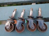 A set of 4 vintage steel furniture castors for sale