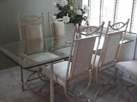 Lovely dinning table and chairs for sale.