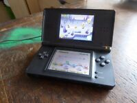 Black Nintendo DS with super mario bros and mains