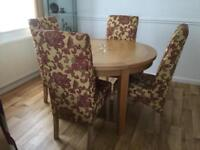 Solid oak round dining table and 4 chairs table extends to sit 6