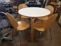 Round modern table with 4 dining chairs