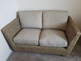 Two seater rattan sofa. M&S Bermuda range. Size: H.91.0 cm x W.147.0 cm x D. 90.0 cm