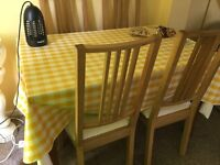 A dining table and 4 chairs