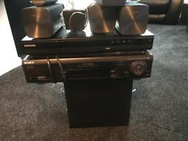 DVD and surround speaker system with DVR cassette player