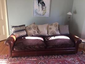 Leather sofa with Velvet seat cushions