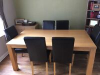 Oak effect dining room table and chairs