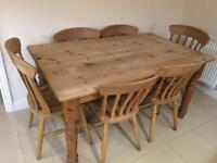 Large solid pine table with 6 pine chairs, 2 are carvers