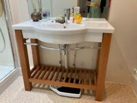 Large sink combined with solid wooden stand
