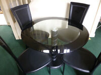 Round Glass Table and Four Black Chairs with matching Coffee Table - Good Condition