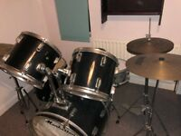 Drum Kit with Multi-directional Tom Mounts and Cymbals
