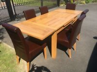 Solid Oak dining table with x 6 leather chairs