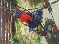 Stroller. navy and red canvas with rain cover. Good condition.