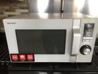 Sharp R244 900w microwave as new.