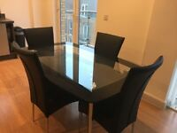 4 seater Glass Dinning Table & Chairs in good condition