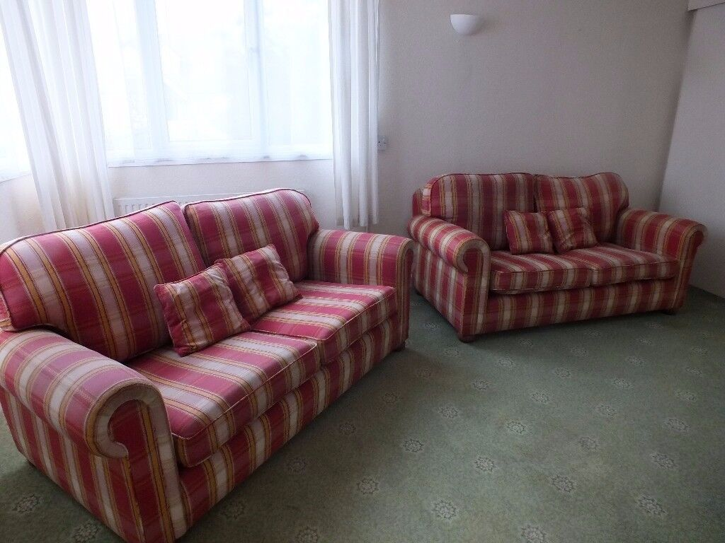 Pair of settees in red check Churchill fabric