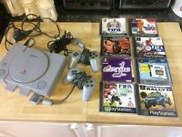 Playstation 1 with 8 games