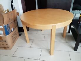Expandable dining table with space for 6