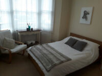 Spacious, bright double room in chic residential area in Fulham available for a short term let.