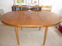 Round, mid-century style table seats 4-6 with expandable centre panel which folds into body of table