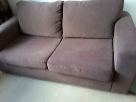 Brown Fabric 2 Seater Sofa Bed. Pulls out to make a Double Bed