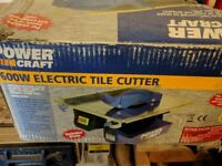 Used tile cutter with new replacement blades