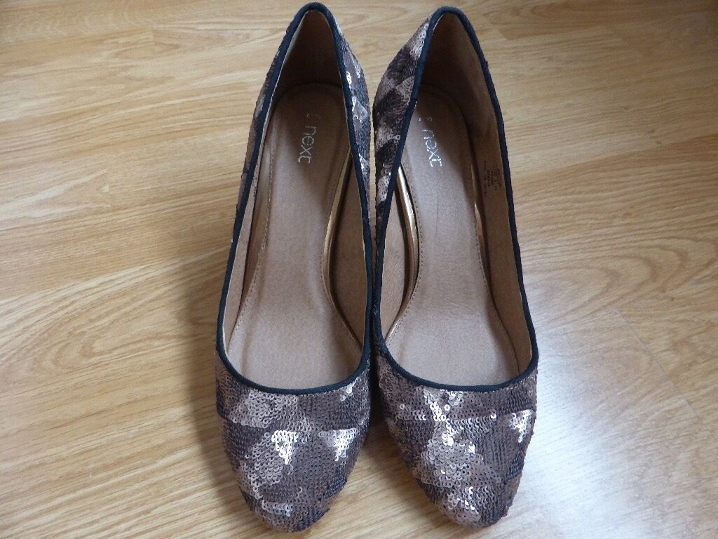 NEXT SPARKLY BRONZE SHOES. UNWORN SIZE 6/39in Morden, LondonGumtree - Fabulous, sparkly, bronze shoes by Next Size 6/39. 3½in.heel. Bought on a whim but never worn!