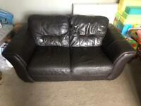 Dark brown leather sofa's and storage foot rest