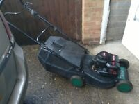 Petrol rotary lawn mower with grass box 4 stroke engine with height adjustment starts first time