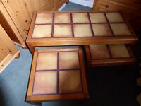 Nest of three coffee tables in Danish oak with beige/brown tiled inlay