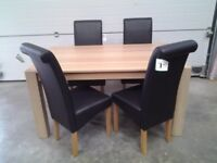 New Dining table and 4 black faux scroll top chairs. Less 1/2 shop price. Boxed. Can deliver.