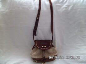 lovely ladies casual pouch style handbag by Ferran Monzo