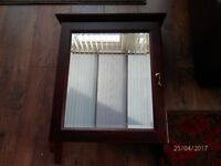 mahogany bathhroom cabinet with bevelled mirror